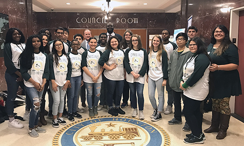 Houston City Councilmen Jerry Davis (center back row) and Dave Martin (back row in gray suit) pose with Cypress Falls High School Debate I students and their teacher Miranda Fairman (right) during a trip to City Hall on Jan. 24. The class recently visited Houston City Hall and attended a City Council meeting to observe government and policymaking in real life. Boykins served as the class' guide.