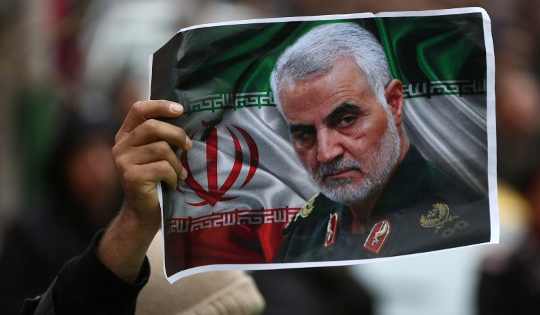 An+Iranian+holds+up+an+image+of+Qasem+Soleimani+%0A+